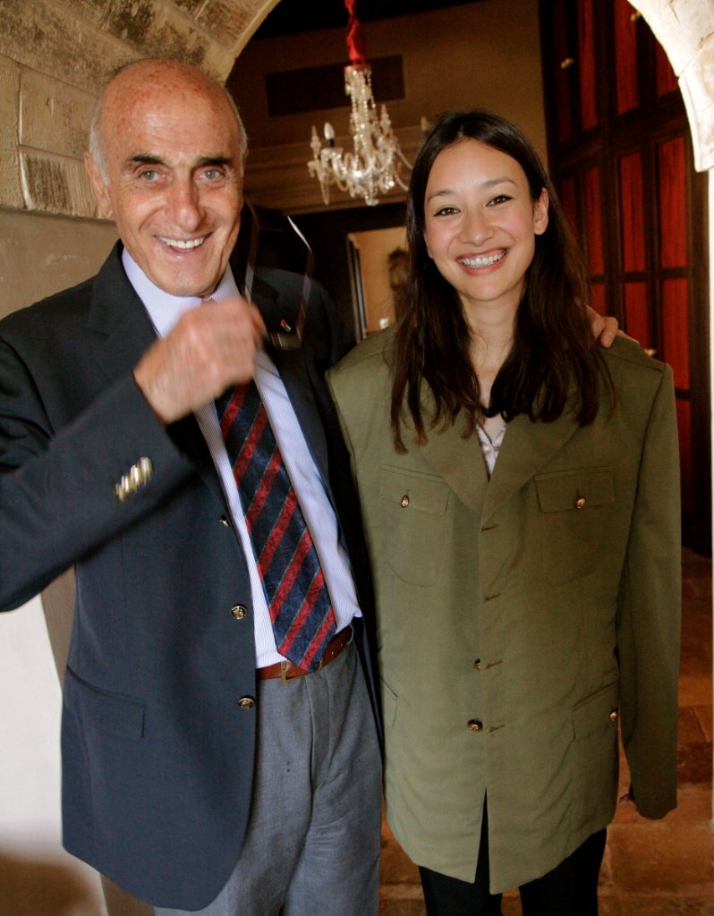 Joanna Natasegara wearing Yasser Arafats jacket with Munib al Musri while filming in the West Bank for The Price of Kings