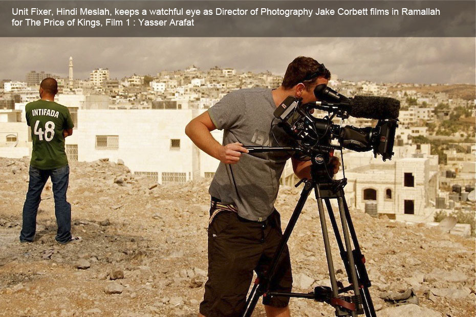 The occupied territories - our unit fixer keeps a watchful eye as Director of Photography Jake Corbett films in Ramallah for The Price of Kings, Film 1 : Yasser Arafat